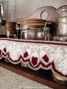 A vintage inspired cross stitch border with scalloped edge